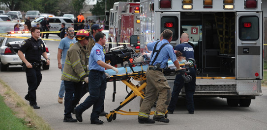 Paramedics scramble on Friday, September 2, 2016 after a gunman shot two school girls in Wichita Falls. Police are searching for a white male about age 18 in the attack.
