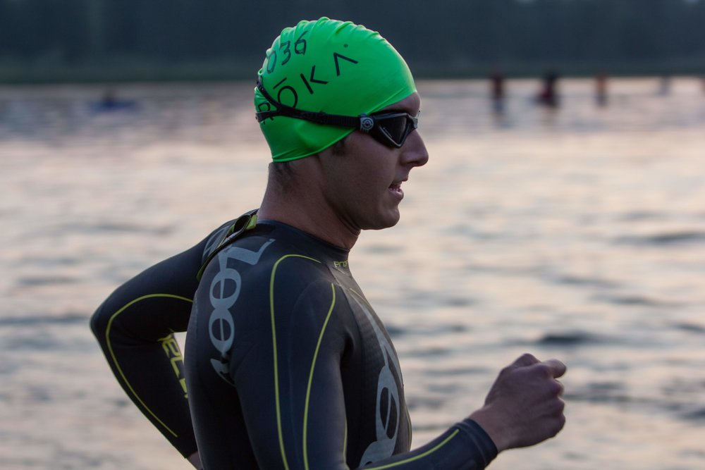Running into the swim with 1,500 Ironman Athletes. Photo Credit: Bill Anderson.
