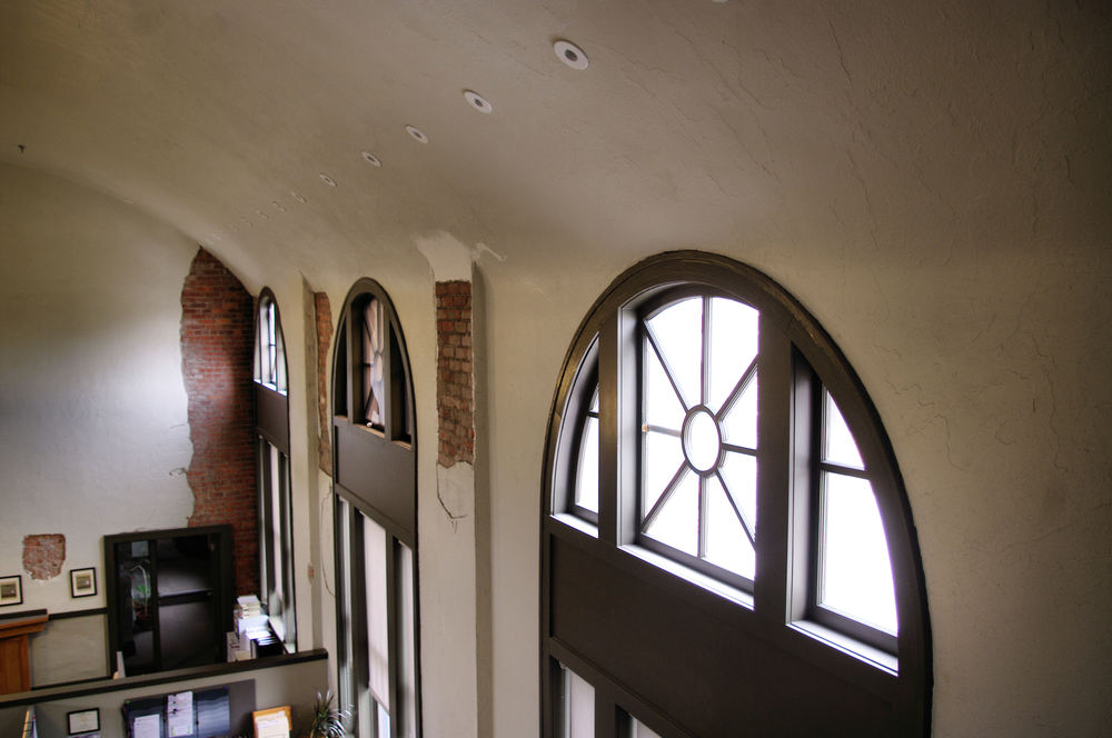 The owner desired to mix new architecture elements with the historic. This included retaining areas of peeled plaster exposing the brick structure.