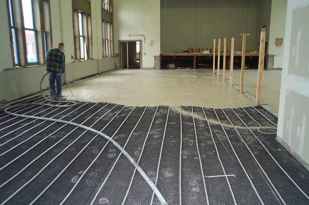 Lightweight gypsum concrete floors serve as thermal mass for radiant heat while also resolving the problem of existing uneven floors.