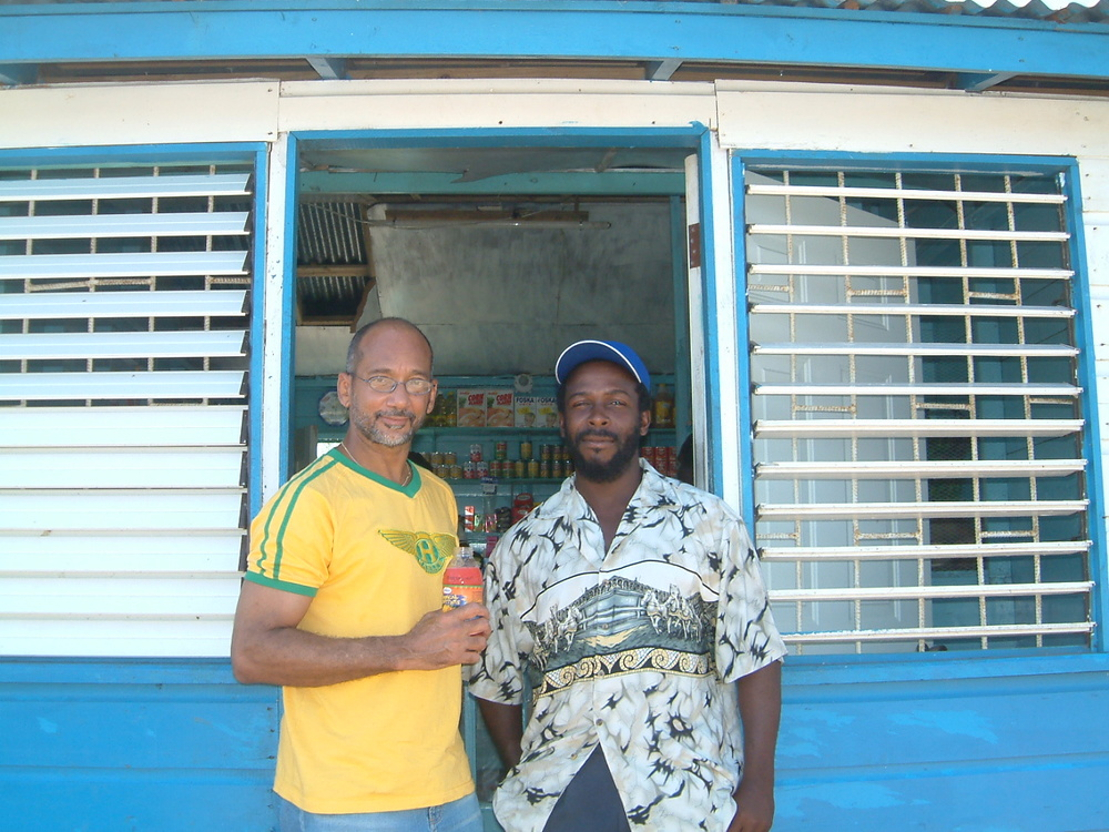 Visiting a shopkeeper customer in rural Jamaica.