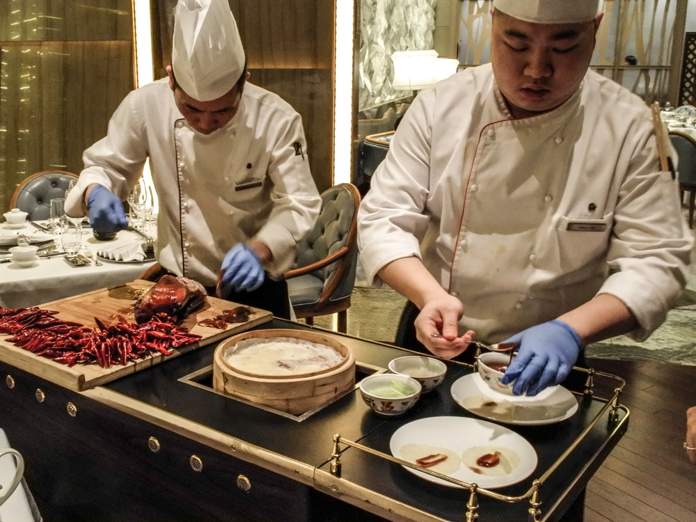 the Yan Ting - chefs preparing Peking duck