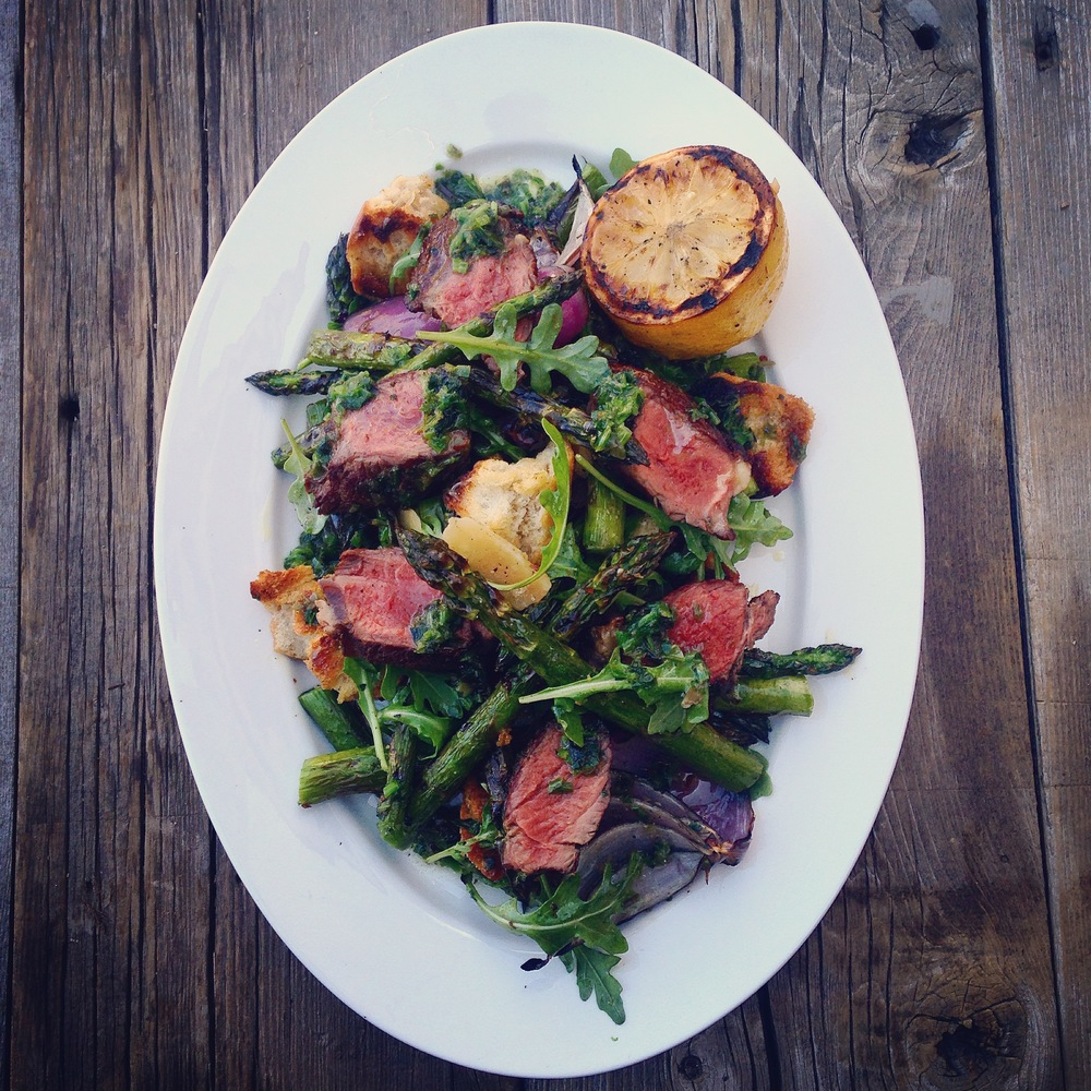 Buffalo meat may be lower in fat and cholesterol, but it still has a rich beefy flavor. We have paired it with a Compound butter made with wild leeks and a twist on a Panzanella salad made with Spring Ontario Asparagus