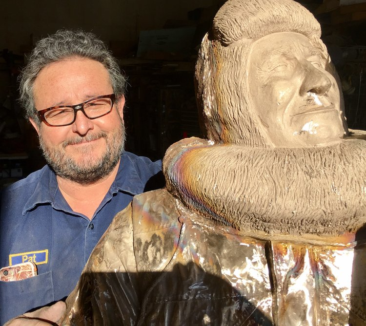 Pat poses with Joe Reddington, his latest bronze work, to be installed in 2017 at the Joe Reddington Junior Senior High School in Wasilla.
