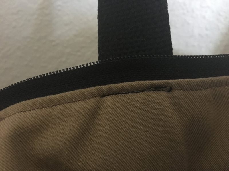In this early Chamomile Tote sample, Mariah forgot to switch her bobbin thread to match the lining for the final step. Not a good looking design detail!