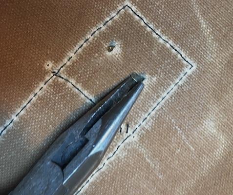 Use pliers to flatten prongs