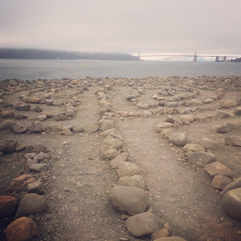 A labyrinth waits at the shore
