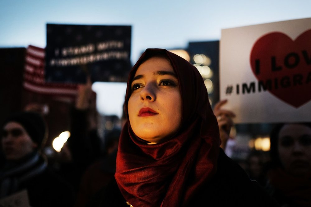 Hundreds of people attend an evening rally at Washington Square Park in support of Muslims, immigrants, and against the building of a wall along the Mexican border, on January 25, 2017 in New York City. photo: Spencer Platt