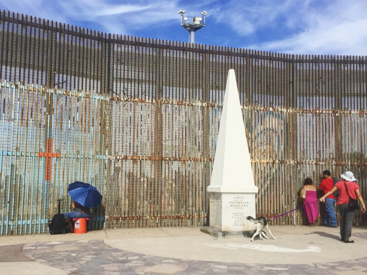 People connecting with their loved ones through the border fence in Tijuana on the U.S.-Mexico border by the last border monument under the U.S. surveillance cameras.   photo: Karoliina Paatos