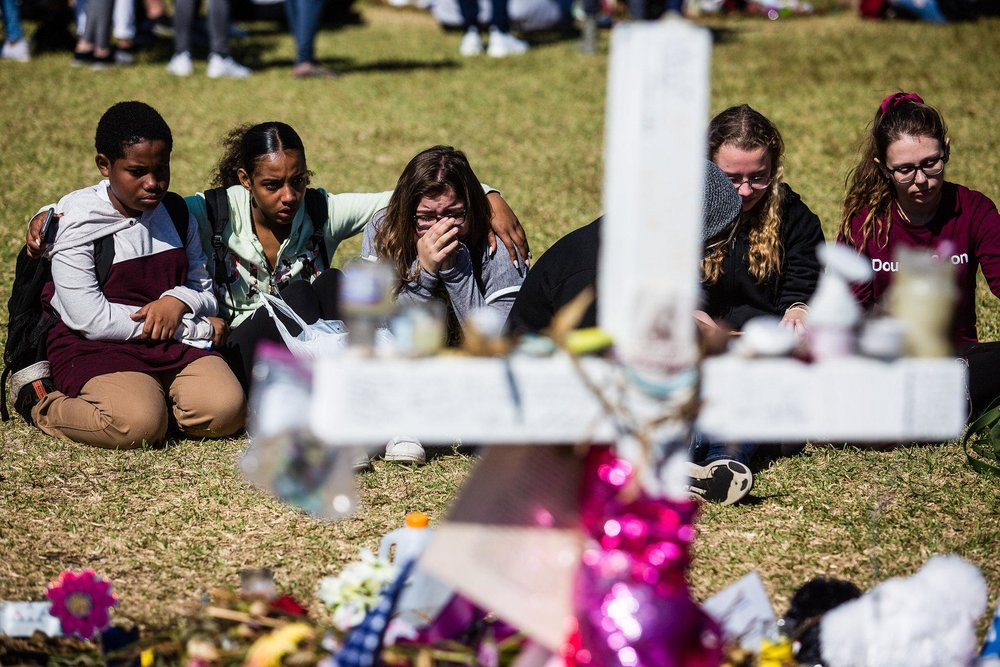 In Parkland, Fla., students gathered at a memorial not far from Marjory Stoneman Douglas High School, where a massacre in February left 17 dead. photo: Saul Martinez