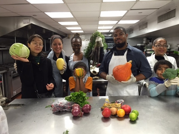 "An ""Iron Chef"" class at Association to Benefit Children where parents created meals utilizing the contents of farm fresh produce without knowing what the ingredients would be. Photo credit: Association to Benefit Children"