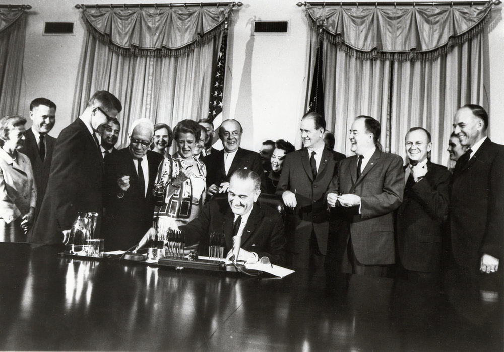 President Johnson signing the Food Stamp Act of 1964.  Credit
