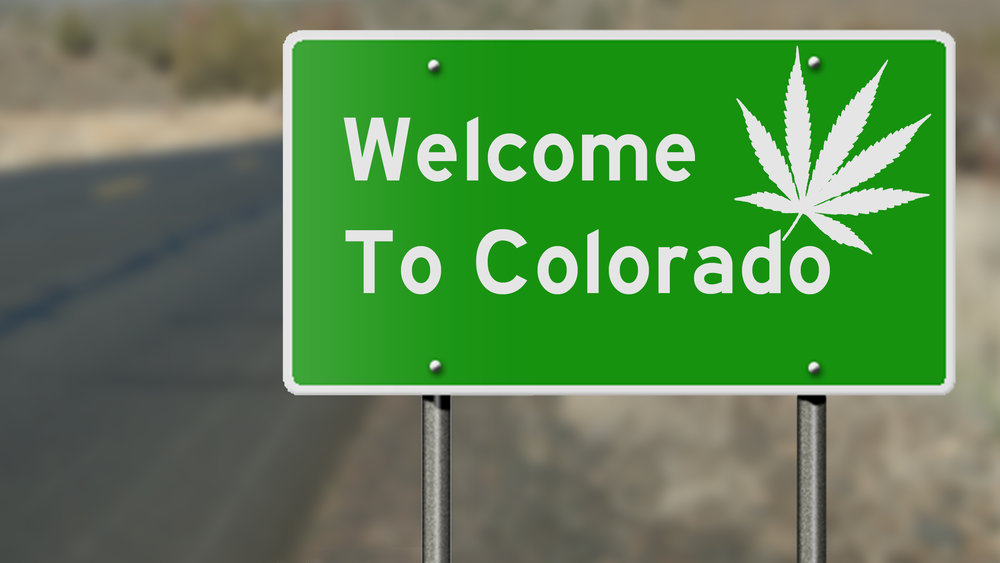 Welcome to Colorado highway sign with marijuana leaf