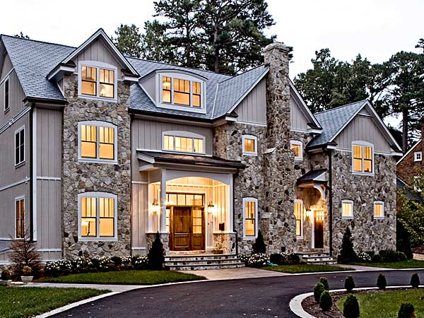 milgard-ultra-fiberglass-windows-on-a-stone-home-with-a-metal-roof.jpg