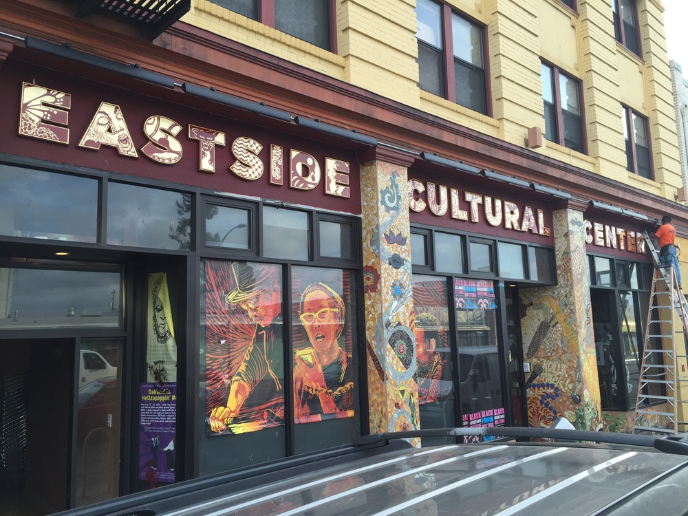 Signage and Window Display  by Thomas Wong with Berkeley Signs and Leslie Lopez  For EastSide Arts Alliance and Cultural Center, Oakland.  Composite Foam, Gold Leaf and Plexiglass, Vinyl Banners