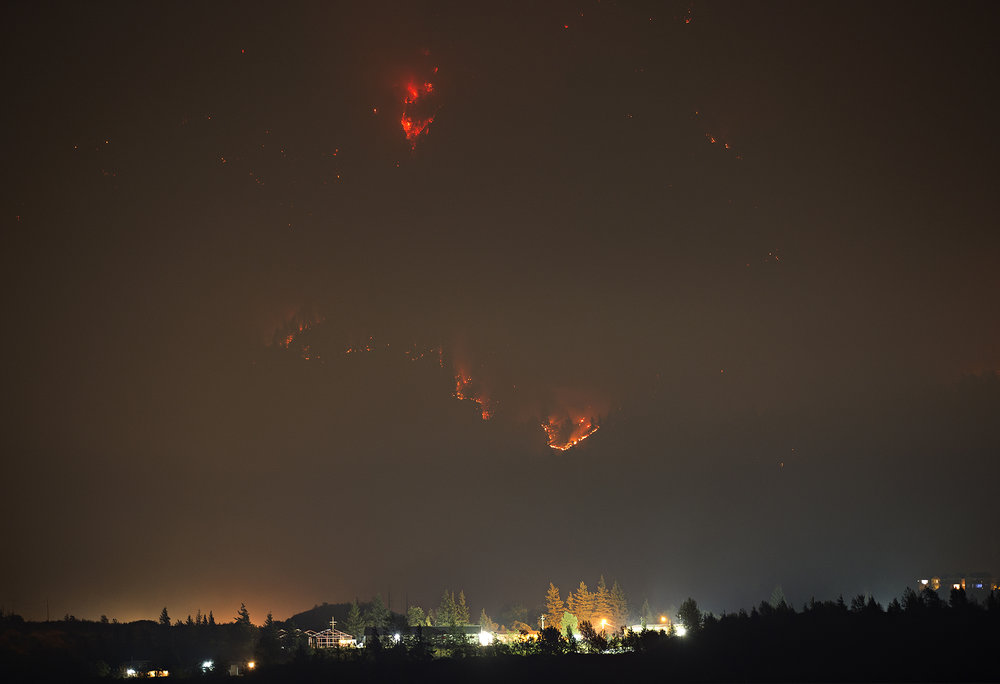 The Eagle Creek fire continues to ravage the Columbia River Gorge on Thursday evening, Sept. 7, 2017 as seen from Stevenson, WA. A 15-year-old boy started the fire by throwing fireworks into the Gorge, igniting a fire that has now grown to 33,000 acres. (The Columbian)