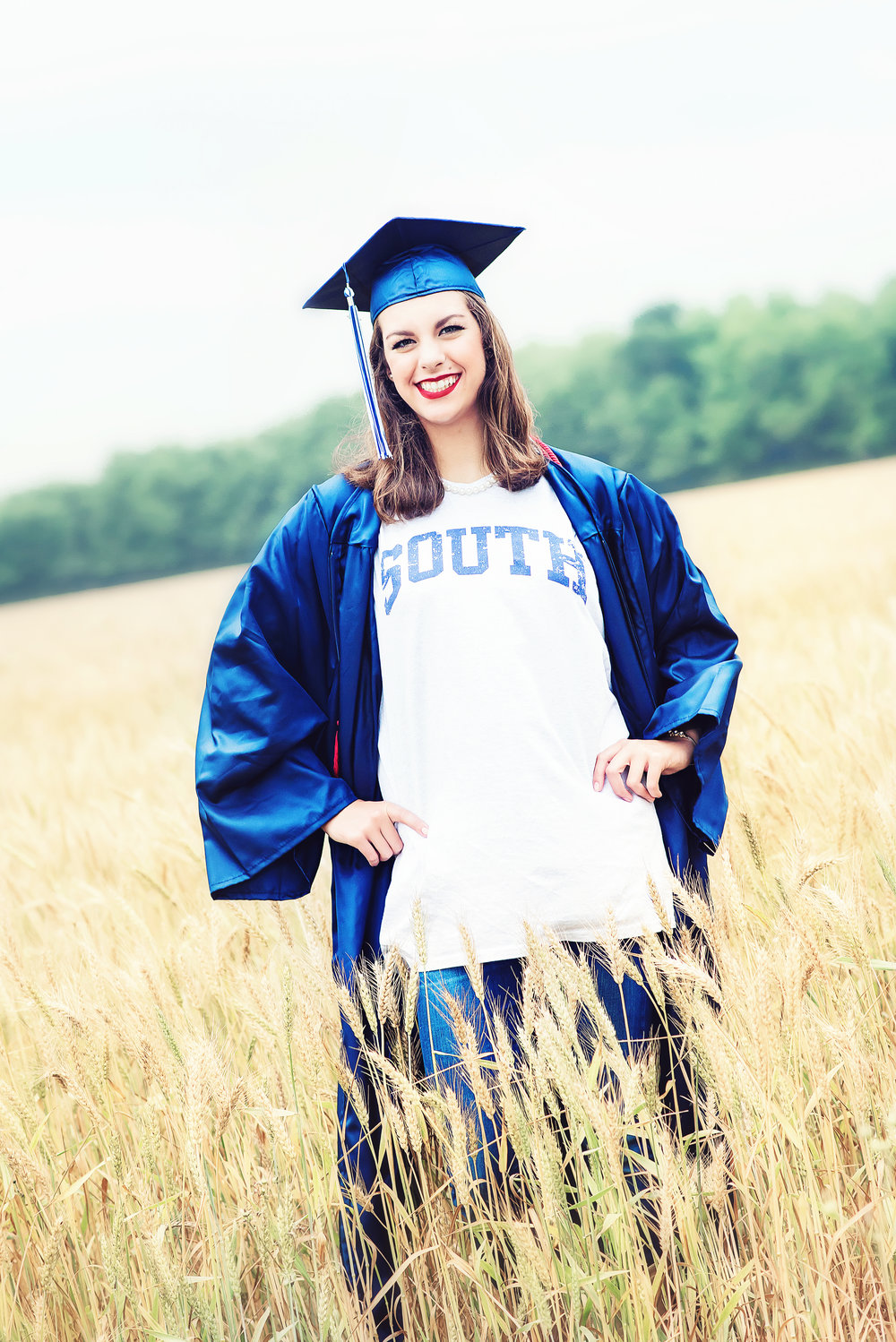 high school cap gown wheat field south.jpg