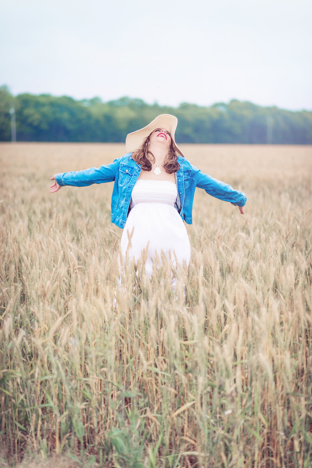 high school senior wheat field excitement - boquet beach portraits - silverhill alabama