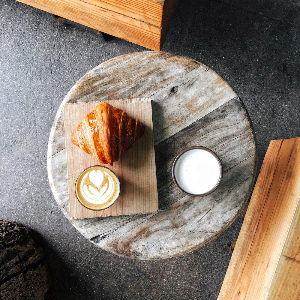 Croissant, cortado and chai latte