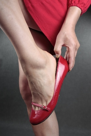12711791_S_woman_red_flat_shoe_unsupportive.jpg