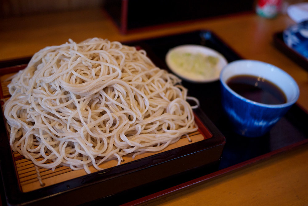 Unsimply Soba: Comics & Competition in Japanese History      Listen Here     Think you can eat 50 bowls of noodles? What about 100? This week, The Feast explores the tradition of wanko soba from Iwate, Japan, where families and friends compete to see who can slurp the most noodles in a single sitting...