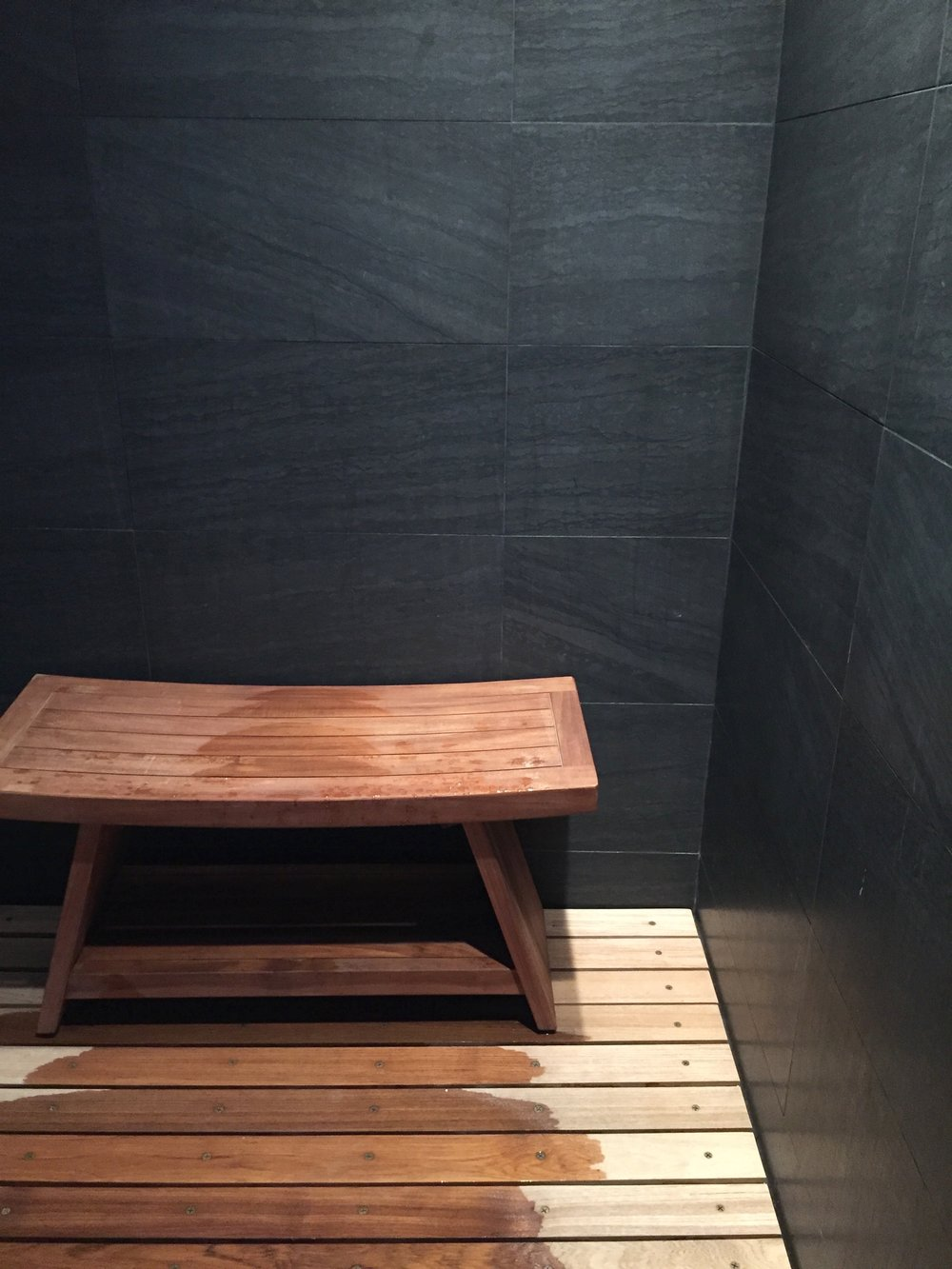 "I designed this shower floor out of teak wood ""decking"" to give a warm feel to your feet that tile cannot. The  teak bench  gives a flexible and comfortable place to sit while showering."