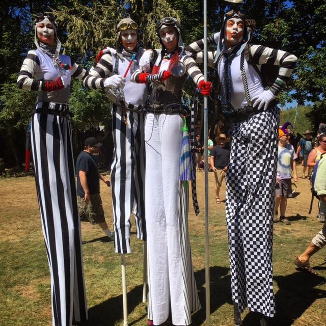 Stilt walkers in character