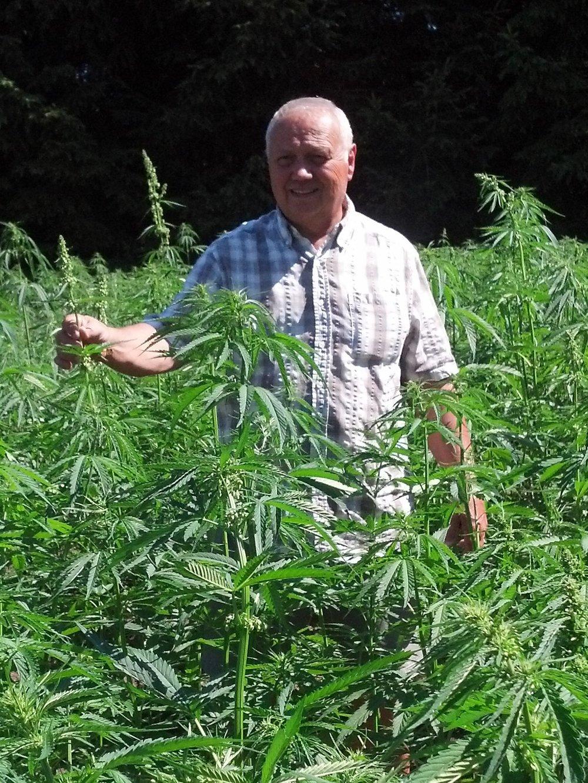 John Baker, MSc, P.Ag among his hemp plants.