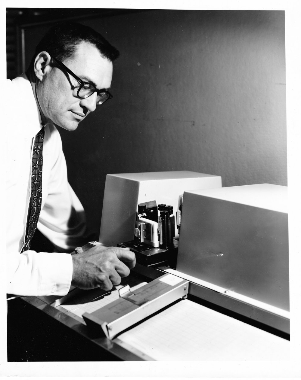 Paul Wilks, c. 1957, with one of his mid-infrared analyzers.