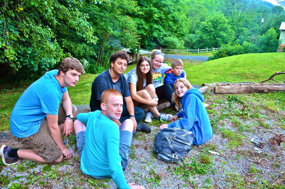 group-huddle-around-the-fire-before-it-gets-dark-and-the-smores-come-out.jpg