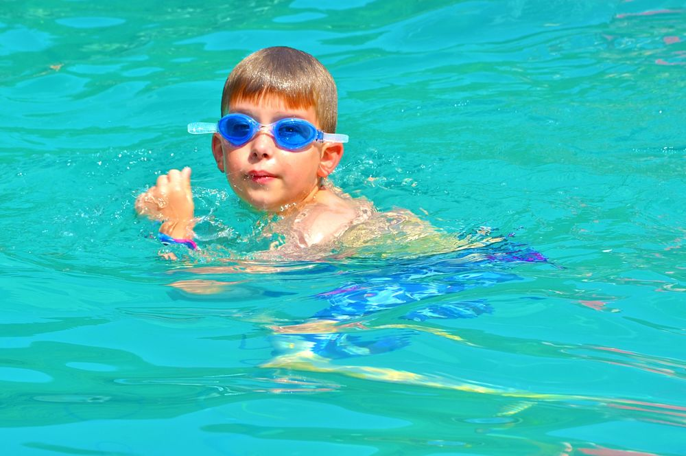 jacob-cools-down-during-free-swim-after-a-hot-day-at-camp.jpg