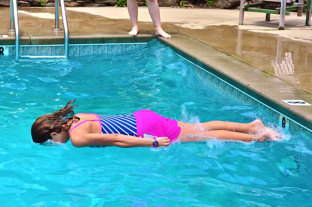 emma-displays-a-perfect-log-drop-into-the-pool.jpg