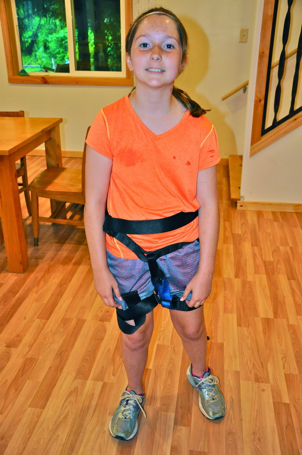 olivia-puts-on-climbing-gear-to-practice-for-the-climbing-wall.jpg
