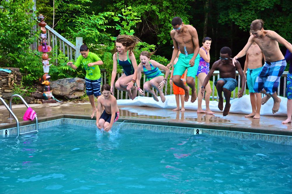 ethan-philippe-yeelen-emily-greg-jazel-and-bruce-all-cannon-ball-into-the-water-trying-to-wet-the-counselors-and-tutors-that-were-sitting-on-the-side.jpg