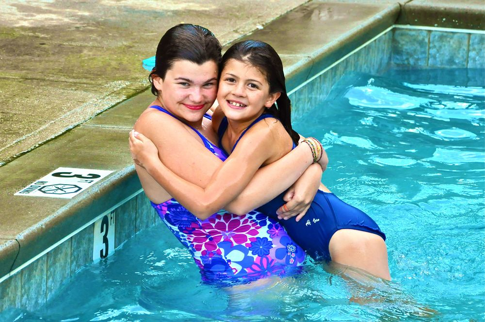 michelle-gives-morgan-a-22big-sister22-hug-in-the-pool-during-a-game-of-water-polo.jpg
