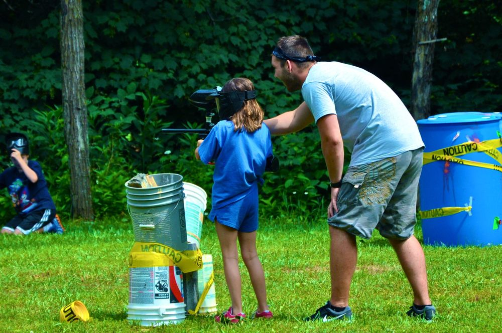 james-guides-morgan-with-how-to-operate-the-paintball-gun.jpg