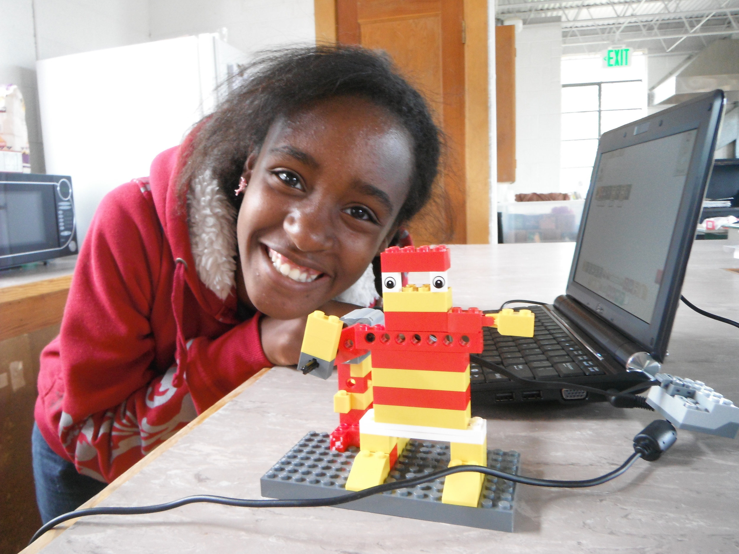 Camper with her robot.