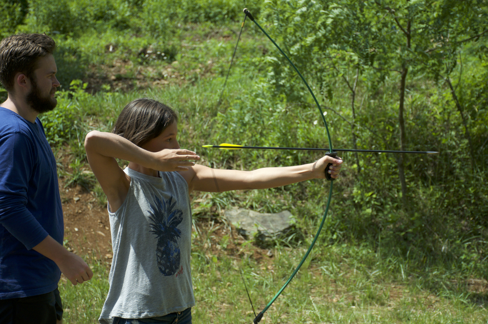 Taking aim in archery.