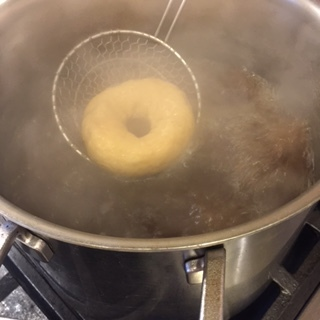 Flipping bagels with a spider.