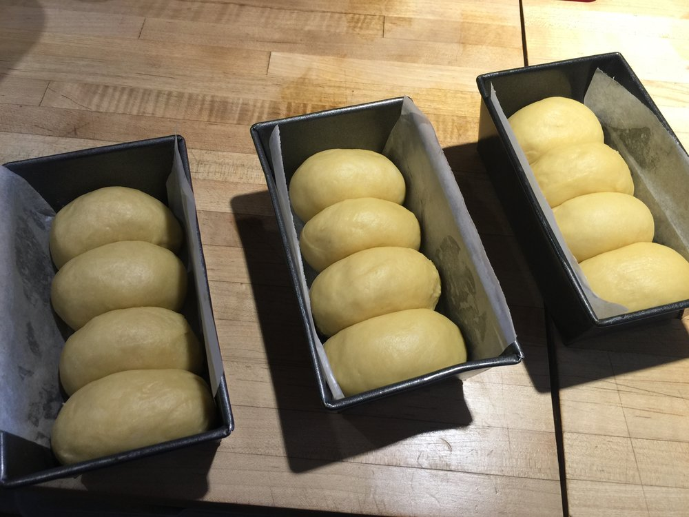 Freshly formed Brioche mini loaves