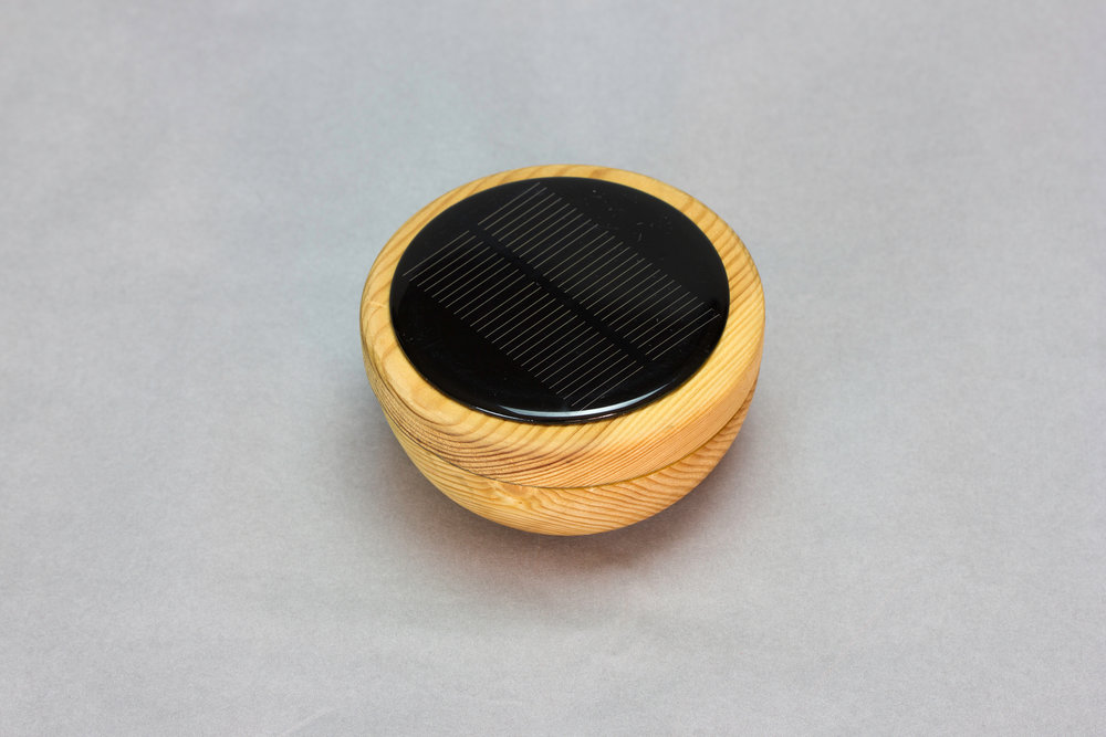 -STONE SOLAR LIGHT-  Round wooden solar light with heart of recycled NOKIA phone battery.