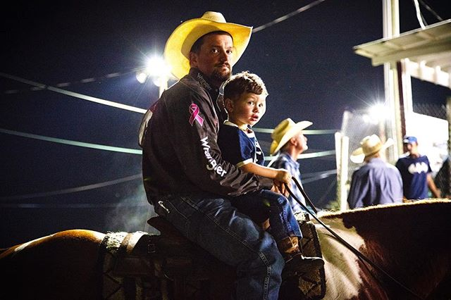 Cowboy JR Meyers and his son at the rodeo. #rodeo #wpra #cowtown #rodeolife #cowgirl #rodeophotography #americanrodeo #cowboys #steerwrestling #tiedownroping #teamroping #barrelracing #horsebackriding #drafthorse #bullriding #saddlebronc #horserider #westernlifestyle #photojournalism #strobes #portrait #saddlebronc #documentaryphotography #profoto #postproduction #editing #photoshop #photography #prorodeo #rodeophotography #rodeotime
