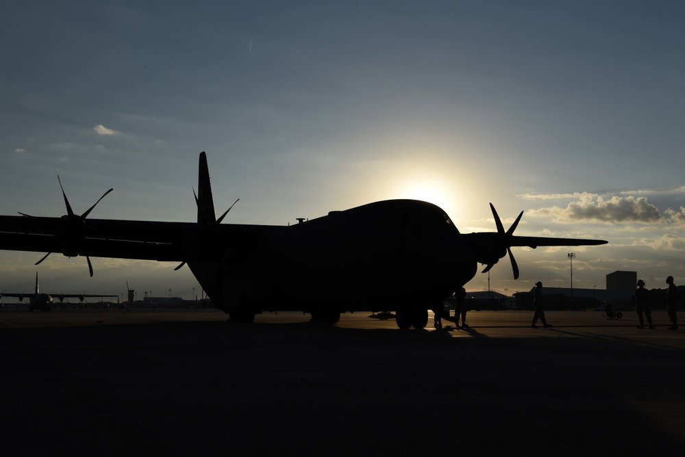 Airmen prepare board a C-130J for a humanitarian mission to Haiti Oct. 7, 2016, at Little Rock Air Force Base, Ark. Hurricane Matthew, a Category 4 hurricane, struck Haiti and the surrounding Caribbean islands initiating a disaster relief response in which Little Rock AFB was a part of.  (U.S. Air Force photo by Kevin Sommer Giron)