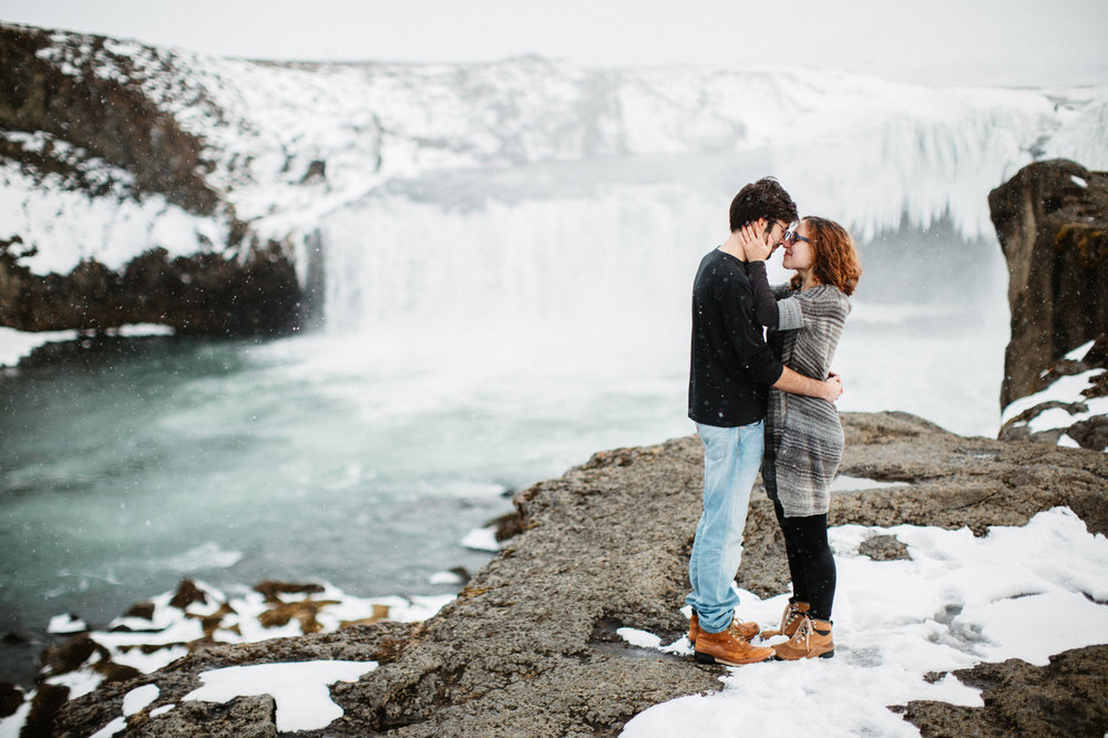 Iceland winter engagement photos taken at Godafoss
