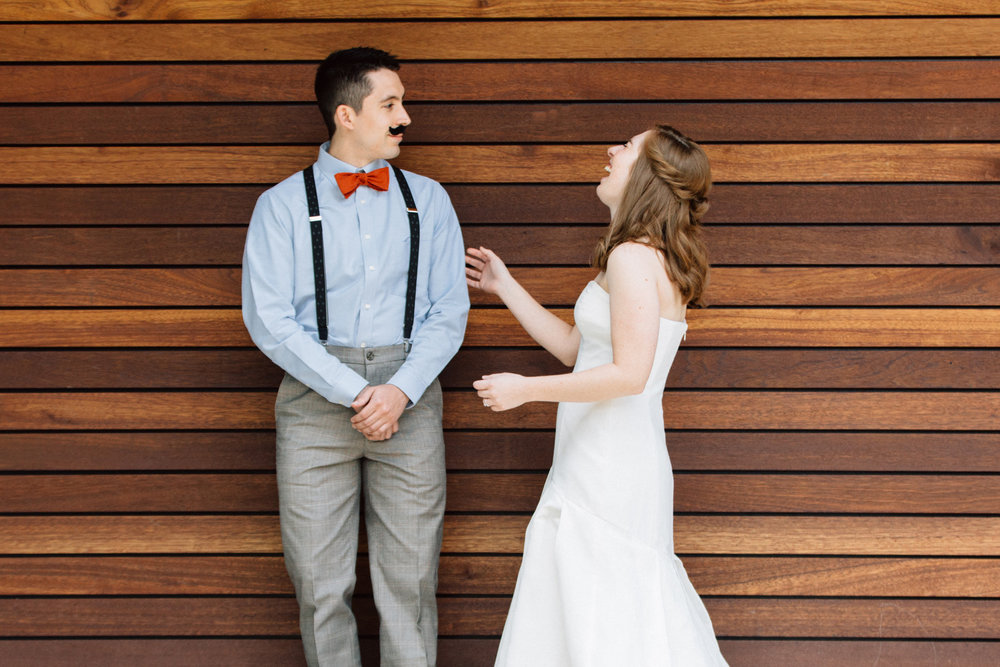 Groom surprising bride with mustache during first look at Portland Oregon wedding