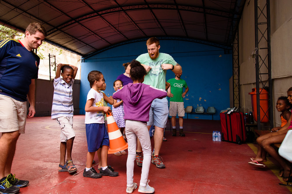 Eric serving at a school in Rio alongside members of the Karis Brazil trip in March of 2017.