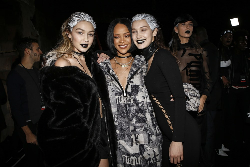 Rihanna backstage with models Gigi and Bella Hadid; image  via