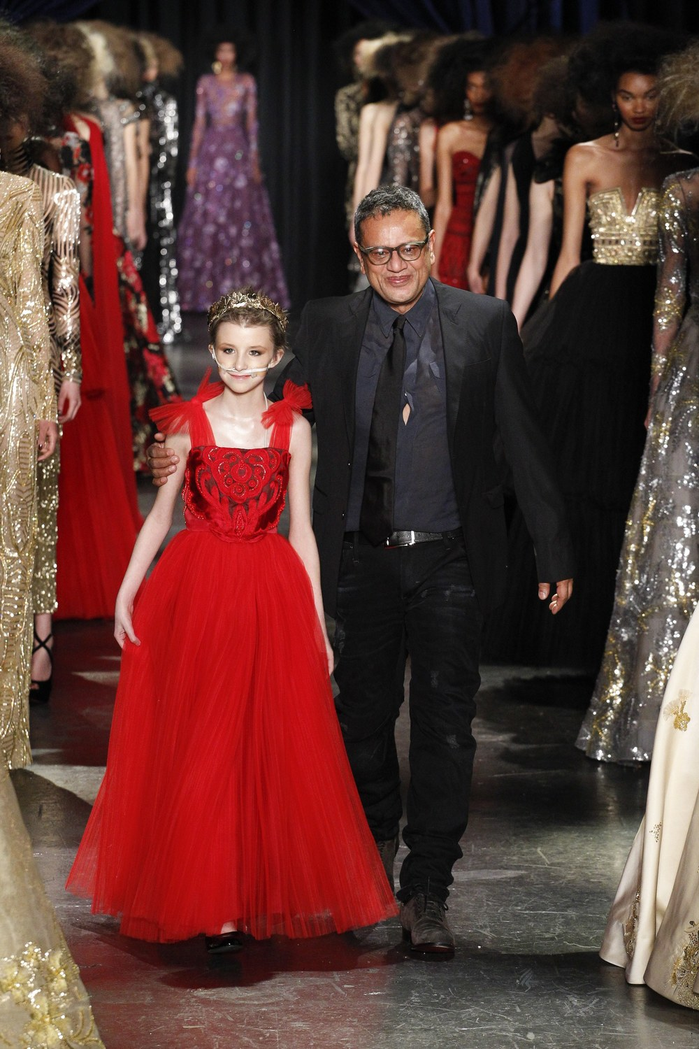 The designer with Trinity Faith Moran (in Naeem Khan);   image  via