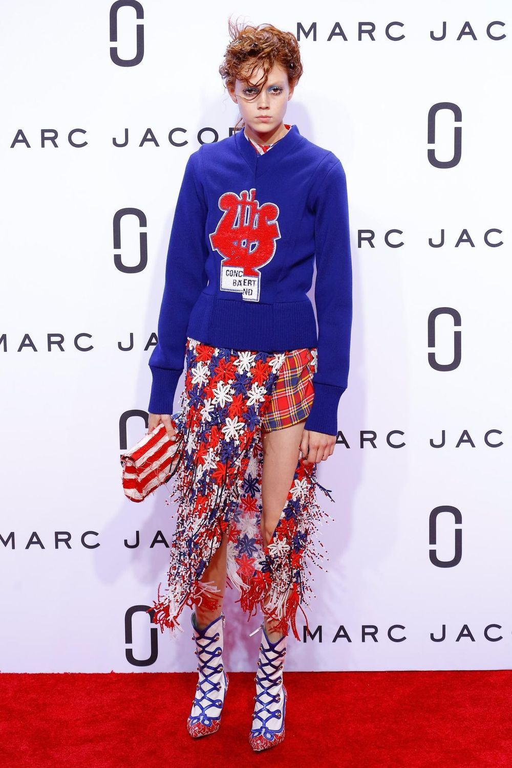 Model Natalie Westling poses on the Marc Jacobs red carpet before strutting down the runway; image via