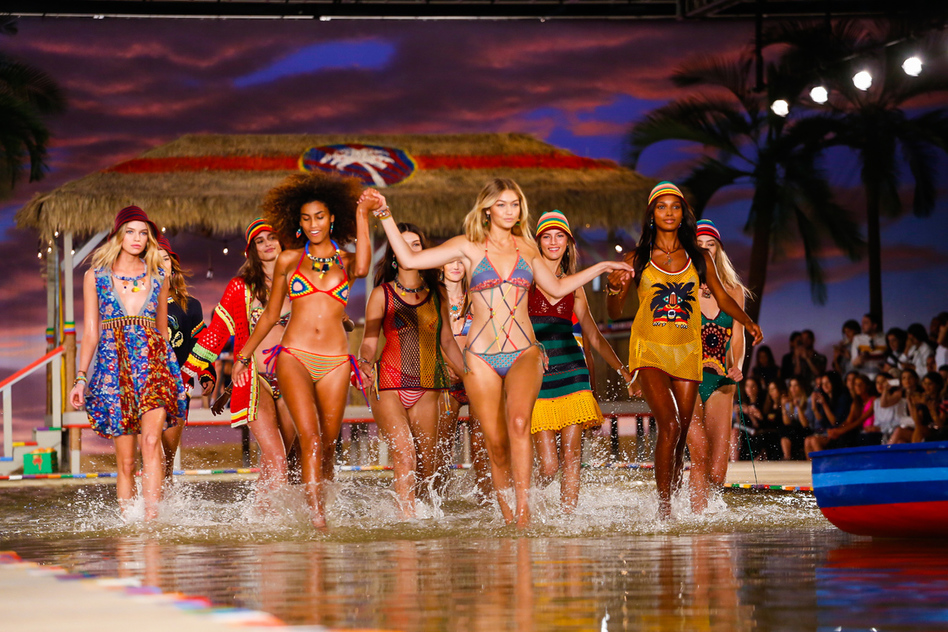 From L to R: models Stella Maxwell, Imaan Hammam, Gigi Hadid and Jasmine Tookes splash around in Hilfiger's makeshift tidal pool; image  via